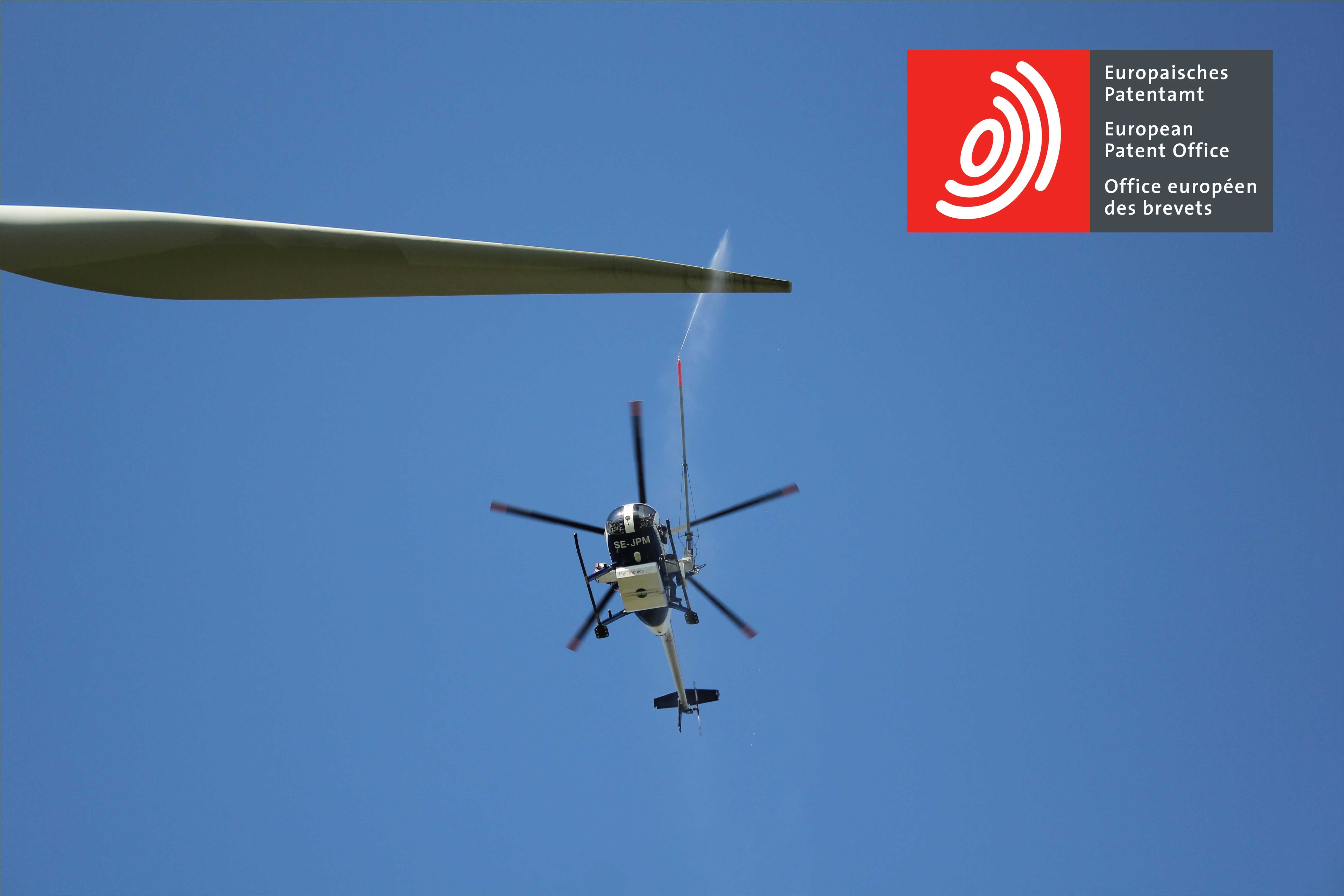 Cleaning Windmill Blades With Helicopter